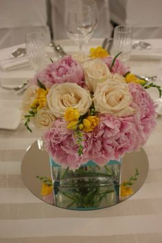 Pink peonies and white roses centerpiece
