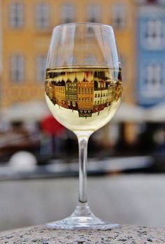 a #CREATIVE way to photograph INTRIGUING ARCHITECTURE - https://www.pinterest.com/DianaDeeOsborne/intriguing-architecture/ - Lovely art despite rather awkward base... a little cafe table's tablecloth would be more natural. #DianaDee - Photography using water in wine glasses for inverse images, for sparkling sunsets, etc.