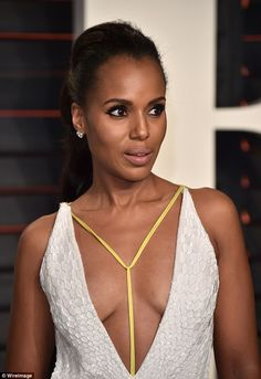 Working it:Ensuring all eyes were well and truly on her, the actress, 38, showed off some serious cleavage as she slipped into a striking silver gown with a dramatically plunging neckline