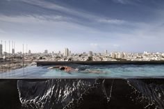 As part of the brief, the architect created a balcony that spans the length of the penthouse, then added an infinity pool that appears to line up with the city skyline.