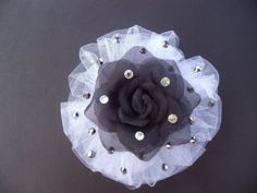 "This is an extra from a custom dance hair piece that was made for a Jazz number, ""God Loves Me"". You can play around with this and add a bit of ""over the top"" to your collection. This piece is has two layers, white tule on the bottom with black rhinestone and an ice rose on top with clear rhinestones. Attached with a french barrette for secure placement."