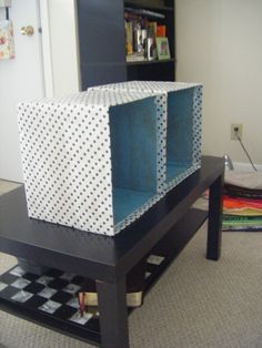 Decorate plain cardboard boxes for storage