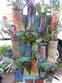 Pottery magnet vases..fresh flowers or herbs on the fridge door!
