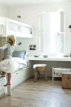 peaceful shared kids bedroom - lots of white , light and bunk beds!