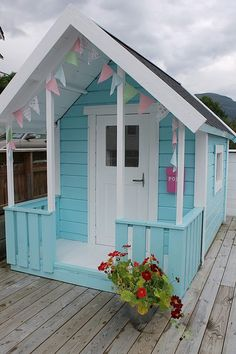 Beautiful sky blue playhouse made from a shed. Gonna have to try remodel our shed this way for the kids!