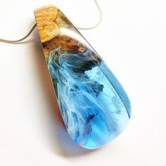 We trapped a piece of the ocean beating up against the rocks. . Blue pendant…