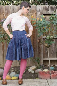 Pink lace top, dark blue skirt, rose-colored OTK socks, cognac clogs.