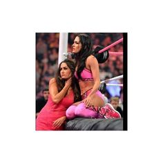 Brie Bella vs. AJ Lee Divas Championship Match photos ❤ liked on Polyvore featuring wwe and bella twins