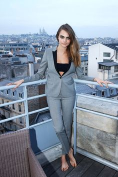 Cara is rocking the smart casual look with a sharp suit and trainers in Paris!