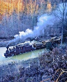 The Shay #19 logging train running down a river somewhere out on the Lilly Fork, West Virgina. The photo was taken on November 24, 1961. [[MORE]] Train track was laid down on the river bed