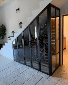 Manufacture of a canopy under the stairs for cellar .- Fabrication d& verrière en sous escalier pour cave à vin à Istres – Fe… Manufacture of a canopy under stairs for wine cellar in Istres – Ironwork for custom creations in Istres – SIMA Ironwork -