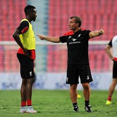 Brendan Rodgers manager of Liverpool talks with Divock Origi of Liverpool during training session at the Rajamangala Stadium on July 13, 2015 in Bangkok, Thailand. (Photo by Andrew Powell/Liverpool FC via Getty Images)