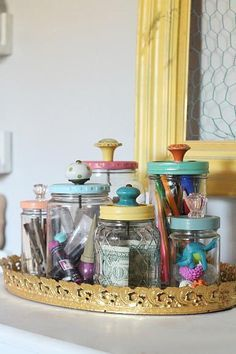 Add pretty knobs to the tops of mason jars for pretty mason jar storage solutions! Lots of options with this easy mason jar trick! Love these recycled food jars turned pretty storage jars with glass knobs! Mason Jars, Mason Jar Storage, Bottles And Jars, Mason Jar Crafts, Glass Jars, Pots Mason, Glass Knobs, Candle Jars, Food Jar