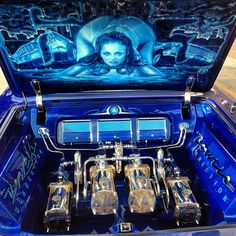 Inside the beast, a look into the trunk if Blue Wave, this 1963 impala custom car stereo trunk install JL Audio