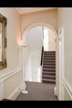 Hall stairs carpet white stripes