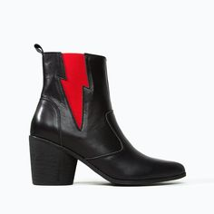 Live your greatest Ziggy Stardust fantasies in these black leather Chelsea boots with our signature lightning bolt gore in red. Black Leather Chelsea Boots, Two Ladies, Thick Socks, 3 Inch Heels, Mid Calf Boots, Shoe Box, Low Heels, Footwear, My Style