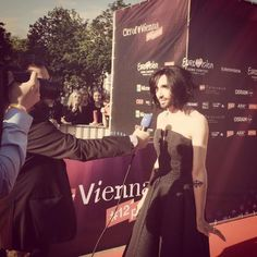 """Wow, another red carpet - in bright sunlight! ❤️ Welcome to Conchita Wurst Eurovision, Eurovision Song Contest, Gives Me Hope, Your Smile, Red Carpet, Strapless Dress, Songs, Formal Dresses, Vienna"