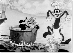 Still from the Mickey Mouse cartoon 'Trader Mickey' (1932) featuring Mickey Mouse playing the saxophone while a cannibal dances