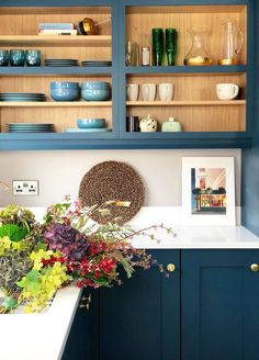 A formerly beige UK home is now brimming with shades of blue. #bluedecor #bluecolorpalette #thingsthatgowithblue #shadesofblue #bluekitchen #kitchenideas #kitchendecor #kitchencabinets #cabinetcolors #paintedcabinets #openshelving Farrow Ball, Hallway Wall Colors, Little Greene Paint Company, Formal Dining Tables, Uk Homes, Interior Stylist, Interior Design, Beautiful Kitchens, Shades Of Blue