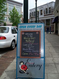 Early Girl Eatery outside street sign. #avl  I love EGE....take out of towners there all the time and they love too