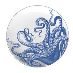 Add a coastal touch to your tablescape with this lovely salad plate, showcasing an octopus motif in blue.