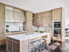 Soft Wooden Kitchen with Large Range and Bar Stools