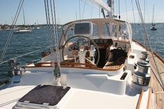 center of boat cockpit, beautiful teak decks. nice combo.