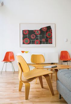 Magill furnished the living area with an Eames coffee table and molded plywood chairs that she bought froma neighbor. The Eames fiberglass chairs were eBaypurchases, and the Alba credenza is from CB2. The lithograph is by St. Louis artist Sage Dawson.  Photo by: Narayan Mahon