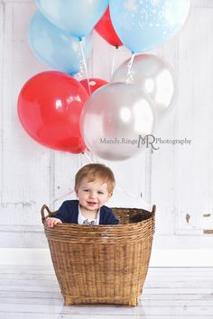 Boy's first birthday portraits // baby in a basket with balloons, hot air balloon, red, blue, silver // Traveling studio session at client's home - South Elgin, IL // by Mandy Ringe Photography