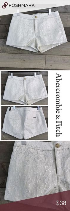 """NWT Abercrombie & Fitch Shorts Silver Floral Brand New With Tags Abercrombie & Fitch Shorts. Cream colored with silver floral design.   Material content is 68% Cotton, 13% Nylon, 11% Metallic, 8% Polyester. Size 0 w25.  Measurements are taken flat and relaxed and are approximately as follows:   Waist across: 15"""" Length: (waist down front) 10.25""""  Has original tags with size, but not price tag as bought for my daughter and she never wore them. Abercrombie & Fitch Shorts"""