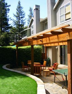 pergola over basement walkout area, just landing and stairs from sliding doors on 1st floor.