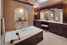 Master #bathroom design with porcelain and glass #backsplash blend by Dal Tile Castle de Verre, tumbled marble #tile in Champagne Gold.