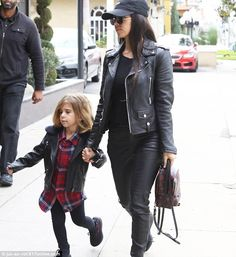 Coordinating in their jackets: Kourtney, 37, chose the same color palette as younger sibling Kim; pictured with her daughter Penelope