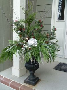 Front porch at Christmas.  Just bought these pots....so doing this!!!