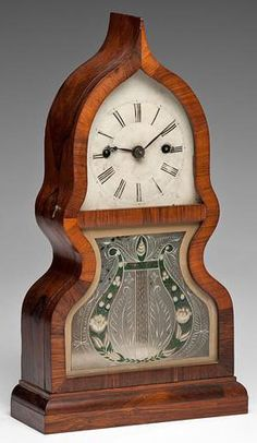 J.C. Brown acorn shelf clock, Bristol, CT, circa 1850. This clock was one of Browns earlier pieces.  his factory burned down in 1850 during which time he was focused primarily on OG clocks. JC Brown is recognized as one of the saviors of the Connecticut clock making industry for his revival of the industry  with the OG shelf clock.