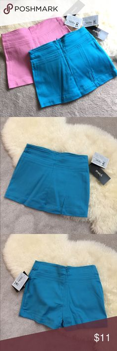 Set of 2 girls skorts in stretchy material Size M stretchy skirt/skorts from Xhilaration. So comfy to play around in! Brand new with tags. Set of 2: bright blue and pale pink Xhilaration Bottoms Skorts