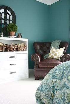 """Paint Color!!! """"Hosta"""" by Martha Stewart And I really like the brown leather chair so my future husband will have some manliness in the room. Love."""