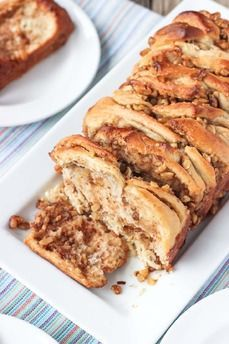 I <3 Walnuts Contest: This Non-Dairt Maple Walnut Pull-Apart Bread is made with a easy homemade yeast dough and bursting with toasted walnut pieces covered in maple syrup. This pull-apart bread recipe uses coconut oil and almond milk to keep it dairy-free, and is sweetened only with maple syrup!