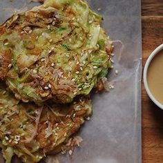 Okonomiyaki - Eggy and crisp, Midge's Kyoto-style pancakes are studded with plump morsels of tender shrimp and threaded through with ribbons of cabbage and rings of scallion.