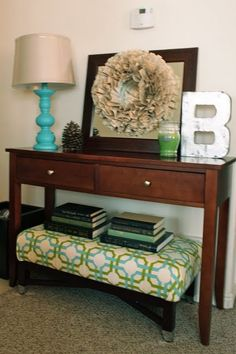 DIY Ottoman Redo... Love the low ottoman under a console table for extra seating and added texture to an entry way or wall in a living room.