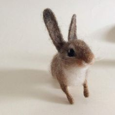 Needle felted baby cotton tail bunny By Hannah Stiles - Made by Hannah Stiles (Ainigmati ) This adorable baby bunny is needle felted with a mix of sheep's wool dyed with henna and natural gray alpaca. About the size of a rabbit kit at two weeks old, he is felted around a wire armature so you can pose him in any position. He has irresistible ...