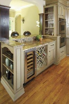 Off white cabinets. Wine rack. Wine fridge in island. Double oven. Granite countertop Kitchens by Woody's 5841 Davis Creek Road Barboursville, WV  (304) 736-2007