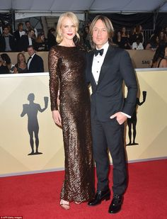Date night! Nicole Kidman chose a sparkling copper colored gown by Armani Prive; she arriv...