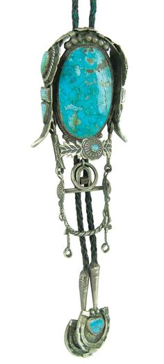 Navajo Bolo Tie:  circa mid 1900s, unique handcrafted bolo in the form of a bridle with straps, rosettes, bits, buckle, etc. with custom horseshoe tips.
