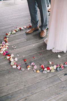 Vows told inside a circle of flowers.