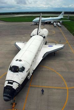Space Shuttle Atlantis with a Boeing 747 in the background