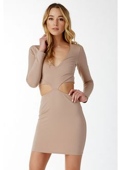 Daring Moment Mini Dress || A heart stopping mini dress that features a deep V-neck neckline and cut outs throughout. Has long fitted sleeves and a straight hem. This dress is sure to stop everyone in their tracks. Pair this with pumps and a clutch.