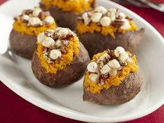 Stuffed Sweet Potatoes with marshmallows, brown sugar and toasted pecans ::xLaurieClarkex~ these are AWESOME!! Leaps and bounds better than the canned sweet potato mush where all you really eat is the toasted marshmallows :-)