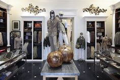 Hackett London store, Milan. Oak wood, photographs and paintings from the 50s and 60s as well as dark stone floors bring British feeling to the Italian fashion capital.