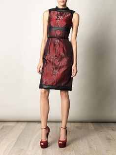 CHRISTOPHER KANE MOIRE STRICT SHIFT DRESS  SIZE UK12 US 8    Metallic red silk blend sleeveless dress from Christopher Kane featuring a red and black abstract pattern, leather short funnel neck, leather bust panel, contrast belt at the waist, a concealed rear zip fastening and leather trimmed hem...